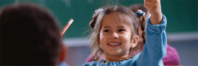 Smiling girl holding up her completed test.